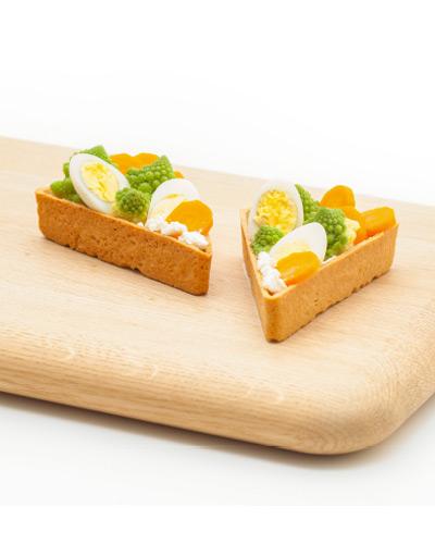 Triangoli con uova di quaglia, broccoli romani e ricotta